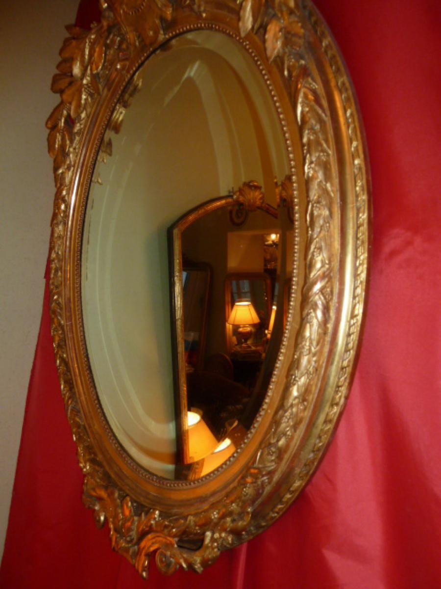 Beau miroir ovale 19 me avec blason et feuilles de laurier for Beaux miroirs